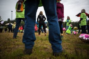 Patricia Maddux, owner of Equipped4Life Fitness, leads the warmup before the Meals on Wheels Walkathon and fundraiser on May 21 on Whidbey Island. (Daniella Beccaria / For the Herald)