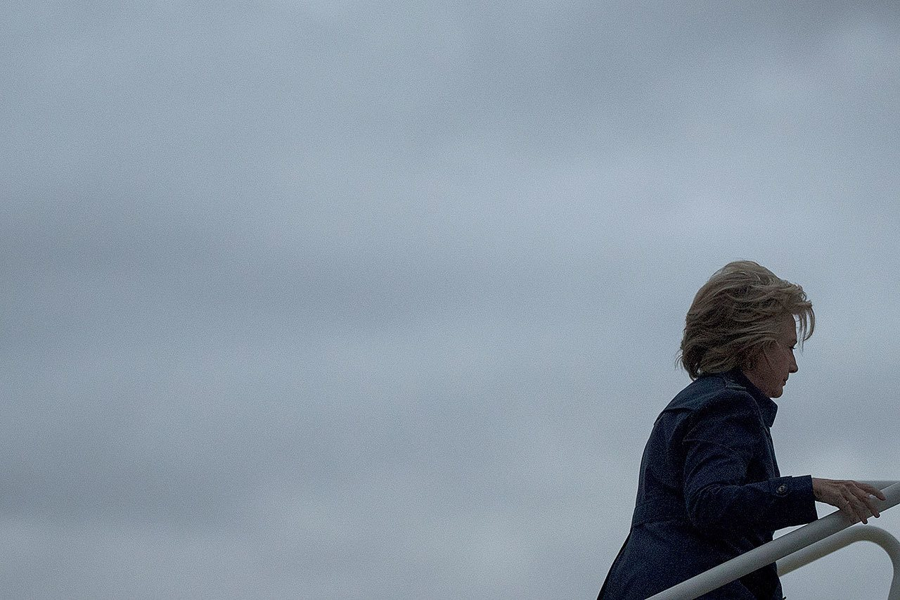 Democratic presidential nominee Hillary Clinton boards her campaign plane in Cleveland, New York, on Friday to travel to White Plains, New York. (AP Photo/Andrew Harnik)