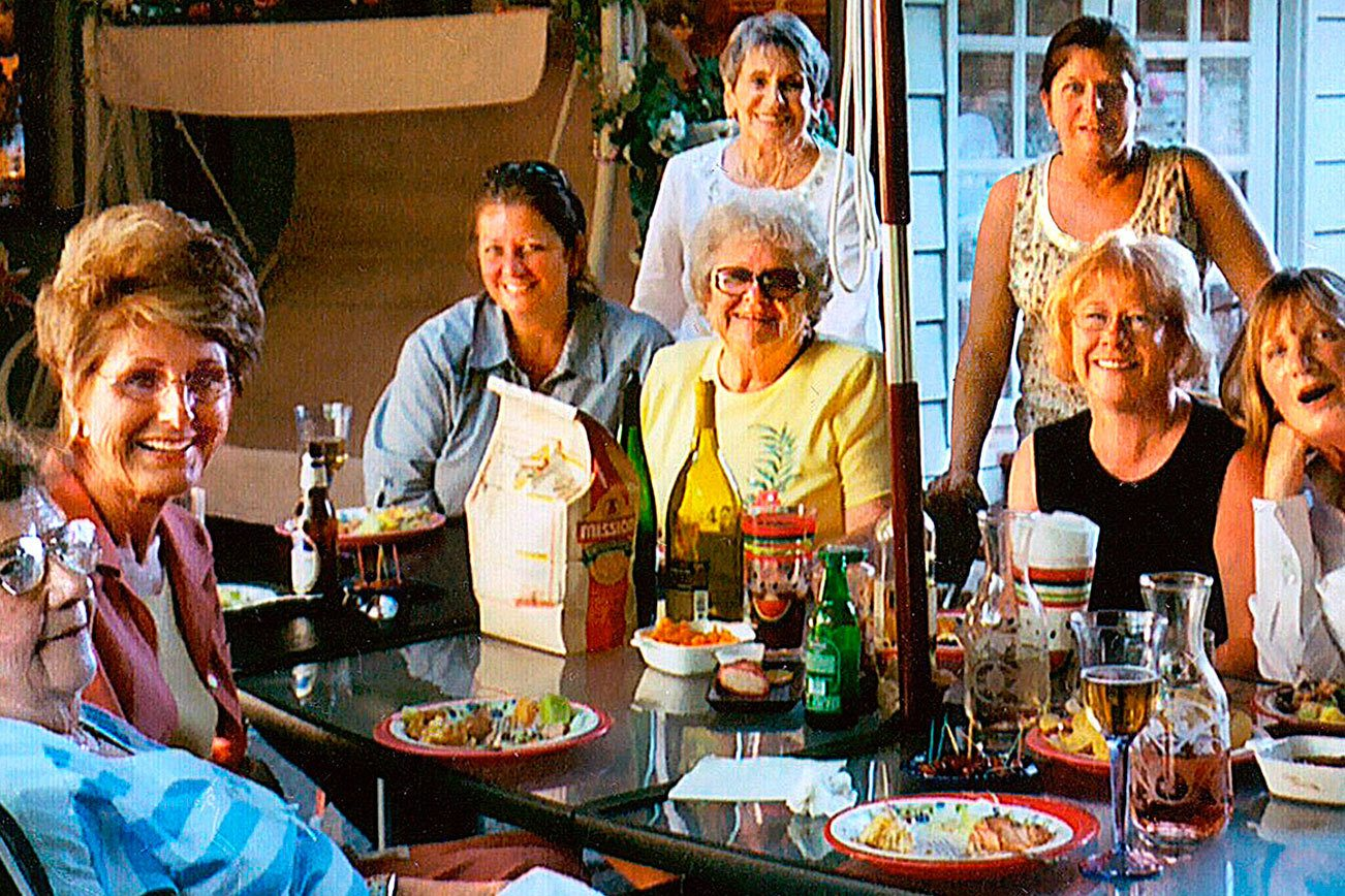 "The ""Bonnettes,"" a group of former downtown Everett Bon Marche employees, at one of their monthly gatherings. Pictured are (from left): Marvel Cummings, Edythe Pavish, Lisa Amundson, the late Goldie Backlezos (standing), Ruth Wilson, Connie Leese (standing), Mary Lou Jones, Kim Goebbert and Val Rude."