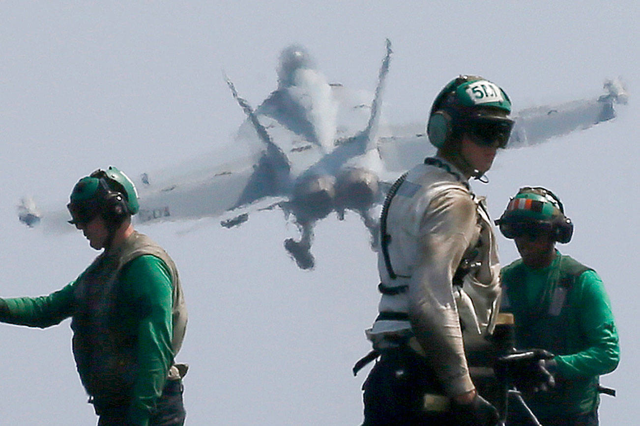 A U.S. Navy F18 fighter jet from the U.S. Navy aircraft carrier USS Carl Vinson (CVN 70) for a patrol off the disputed South China Sea Friday, March 3, 2017. The U.S. military took journalists Friday to the carrier on routine patrol off the disputed South China Sea, sending a signal to China and American allies of its resolve to ensure freedom of navigation and overflight in one of the world's security hotspots.(AP Photo/Bullit Marquez)