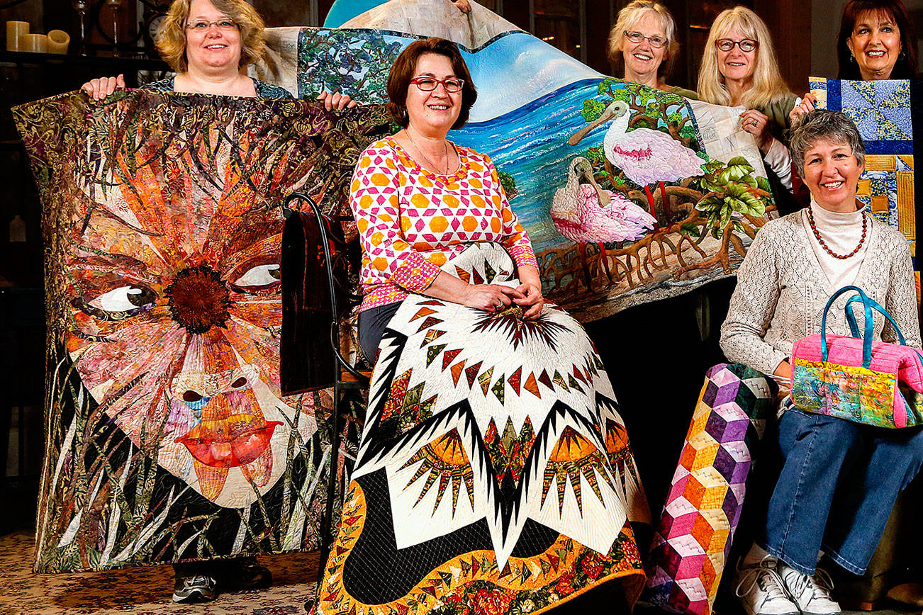 A first-ever Everett Quilt Show is scheduled for Friday and Saturday at Xfinity Arena conference center. It's presented by some extraordinarily talented quilters in the Marysville-based All in Stitches Quilt Guild. They met Tuesday at the Living Room Coffee House, bringing with them a few masterpieces. From left are Tammy Mohiswarnath, Grace Hawley, Becky Ray, Kathy McNeil, Cathryn Scott, Shawna Gould, Darlene McCourt, Vicki Hesseltine and Shirley Rock.